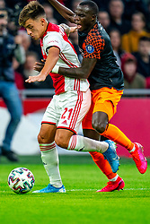 Lisandro Martinez #21 of Ajax and Bruma #7 of PSV Eindhoven in action during the match between Ajax and PSV at Johan Cruyff Arena on February 02, 2020 in Amsterdam, Netherlands