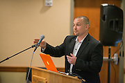 Nate Riggs, founder and president of NR Media Group speaks at the Marketing Symposium. Photo by Ben Siegel