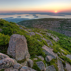 Frenchman Bay and the Porcupine Islands at sunrise as seen from Cadillac Mountain in Maine's Acadia National Park.