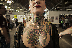 October 5, 2018 - Barcelona, Catalonia, Spain - Woman shows her tattooed chest during the 21st tattoo and urban culture Expo in Barcelona. (Credit Image: © Celestino Arce Lavin/ZUMA Wire)