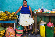 09 JANUARY 2007 - GRANADA, NICARAGUA: A fruit vendor at her stand in Granada, Nicaragua. Granada, founded in 1524, is one of the oldest cities in the Americas. Granada was relatively untouched by either the Nicaraguan revolution or the Contra War, so its colonial architecture survived relatively unscathed. It has emerged as the heart of Nicaragua's tourism revival.  Photo by Jack Kurtz
