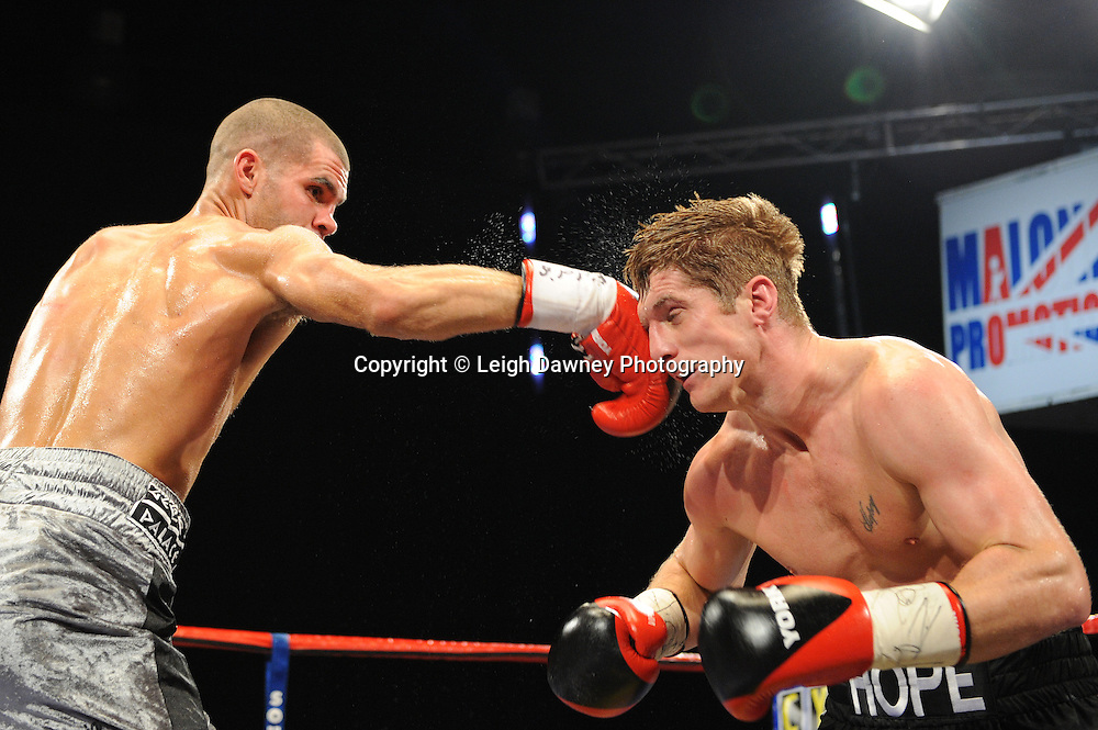 Kerry Hope (black shorts) defeats Tony Hill in a 10x3 British Middleweight Eliminator at the Premier Suite, Reebok Stadium, Bolton, UK on 22.10.11. Frank Maloney Promotions. Photo credit: © Leigh Dawney.