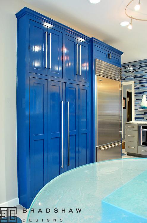 Olmos Park kitchen is modern blue light bright and fresh.  A magazine favorite. Bradshaw Designs kitchen designers in San Antonio Texas.