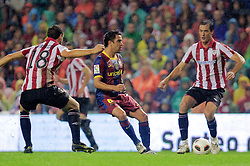 25.09.2010, San Mames, Bilbao, ESP, Primera Division, Athletic Bilbao vs FC Barcelona, im Bild Atletic de Bilbao's Carlos Gurpegui (l) and Igor Gabilondo and FC Barcelona's Xavi Hernandez  during La Liga match. EXPA Pictures © 2010, PhotoCredit: EXPA/ Alterphotos/ Acero +++++ ATTENTION - OUT OF SPAIN / ESP +++++