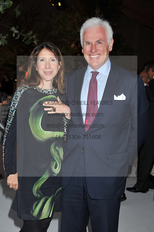 JOHN & the hON.MRS DANILOVICH at a dinner hosted by Cartier following the following the opening of the Chelsea Flower Show 2012 held at Battersea Power Station, London on 21st May 2012.
