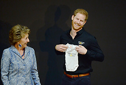 The Duke of Sussex receives a gift for his new son, Archie, from Princess Margriet of the Netherlands at a sports training session at Sportcampus Zuiderpark during a visit to The Hague as part of a programme of events to mark the official launch of the Invictus Games, Netherlands.
