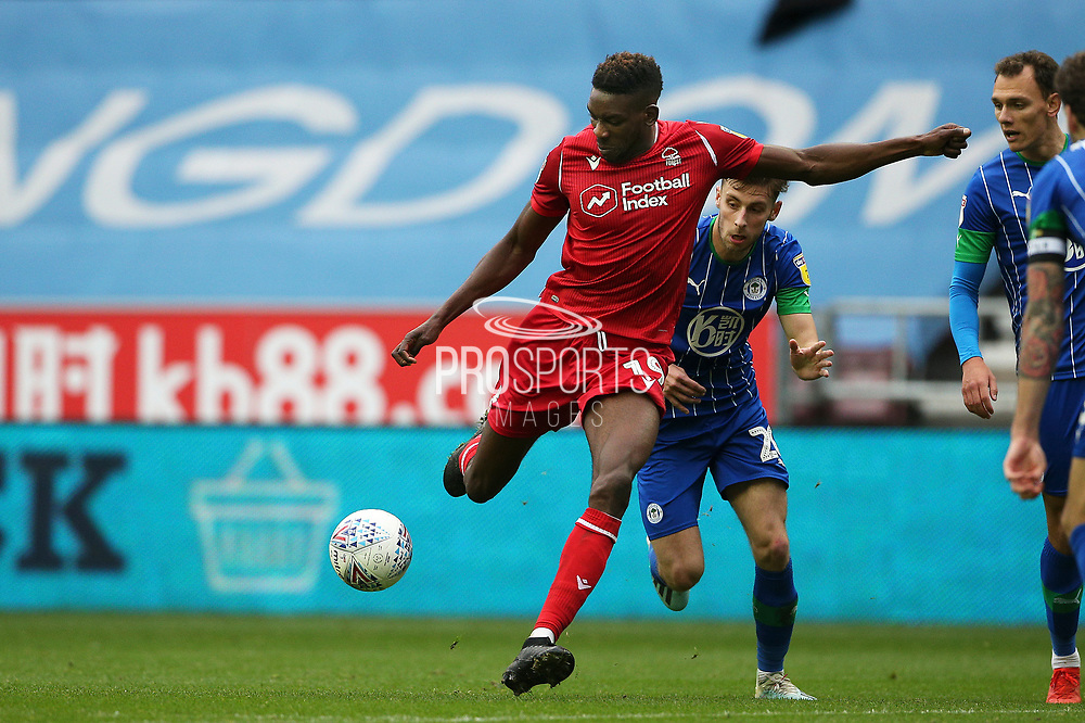 Nottingham Forest forward Sammy Ameobi (19) gets the shot away during the EFL Sky Bet Championship match between Wigan Athletic and Nottingham Forest at the DW Stadium, Wigan, England on 20 October 2019.