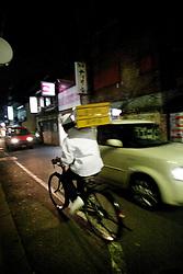 Japan, Tokyo.<br /> A night street scene.<br /> &copy;Carmen Secanella.