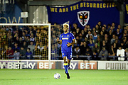 AFC Wimbledon striker Lyle Taylor (33) dribbling during the EFL Sky Bet League 1 match between AFC Wimbledon and Milton Keynes Dons at the Cherry Red Records Stadium, Kingston, England on 22 September 2017. Photo by Matthew Redman.