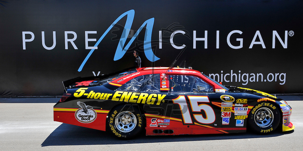 Brooklyn, MI - JUN 15, 2012: Clint Bowyer (15) drives into the garage during practice for the Quicken Loans 400 race at the Michigan International Speedway in Brooklyn, MI.
