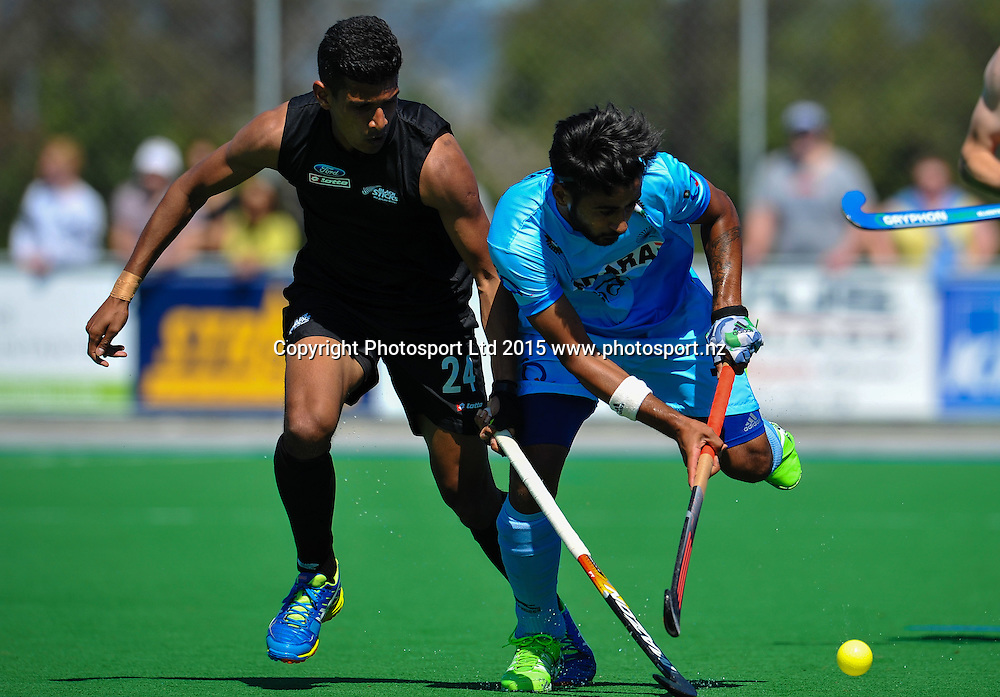 Manpreet Singh of India eludes Arun PANCHIA of the Black Sticks during the Mens Hockey International, 2015 South Island Tour game between the New Zealand Black Sticks V India, at Marist Park, Christchurch, on the 11th October 2015. Copyright Photo: John Davidson / www.photosport.nz