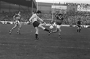 Kerry throws his arms up in an attempt to stop a kick from Dublin during the All Ireland Senior Gaelic Football Final Dublin v Kerry in Croke Park on the 26th September 1976. Dublin 3-08 Kerry 0-10.