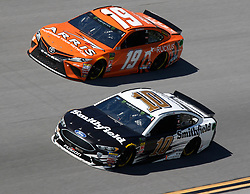 April 29, 2018 - Talladega, AL, U.S. - TALLADEGA, AL - APRIL 29: Daniel Suarez, Joe Gibbs Racing, Toyota Camry ARRIS (19) and Aric Almirola, Stewart-Haas Racing, Ford Fusion Smithfield (10) during the running of the 49th annual Geico 500 on Sunday April 29,2018 at Talladega Superspeedway in Talladega, Alabama (Photo by Jeff Robinson/Icon Sportswire) (Credit Image: © Jeff Robinson/Icon SMI via ZUMA Press)