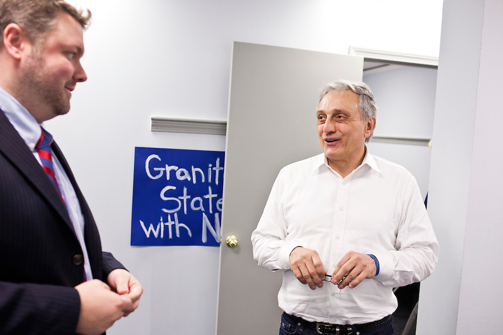 Former New York Republican gubernatorial candidate Carl Paladino, right, talks with Bob Burns, deputy campaign director for Newt Gingrich's New Hampshire campaign at Gingrich's New Hampshire campaign headquarters on Sunday, January 8, 2012 in Manchester, NH. Brendan Hoffman for the New York Times