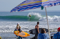 Max Cail catching a wave competing in the Pro Division at the Rincon Classic Surf Contest in Carpinteria, California.