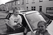 Kids playing by a car Newport South Wales