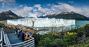 Perito Moreno Glacier's loud cracks, groans, and calvings captivated us for hours from intimate viewing platforms on Lake Argentino, in Santa Cruz Province, Argentina, Patagonia, South America. The spectacular Perito Moreno Glacier is one of 48 glaciers fed by the Southern Patagonian Ice Field (the world's third largest reserve of fresh water). Moreno Glacier melts into Lake Argentino, surrounded by Los Glaciares National Park. Lago Argentino is the biggest freshwater lake in Argentina and reaches as deep as 500 meters (1640 feet). Its outlet, the Santa Cruz River, flows into the Atlantic Ocean. Despite most glaciers worldwide retreating due to global warming, Perito Moreno Glacier has been a relatively stable exception for the past hundred years. Located 78 kilometers (48 mi) from El Calafate, the glacier was named after explorer Francisco Moreno, a pioneer who studied the region in the 1800s and defended the territory of Argentina in the conflict surrounding the international border dispute with Chile. Los Glaciares National Park is honored on UNESCO's World Heritage List. This image was stitched from multiple overlapping photos.