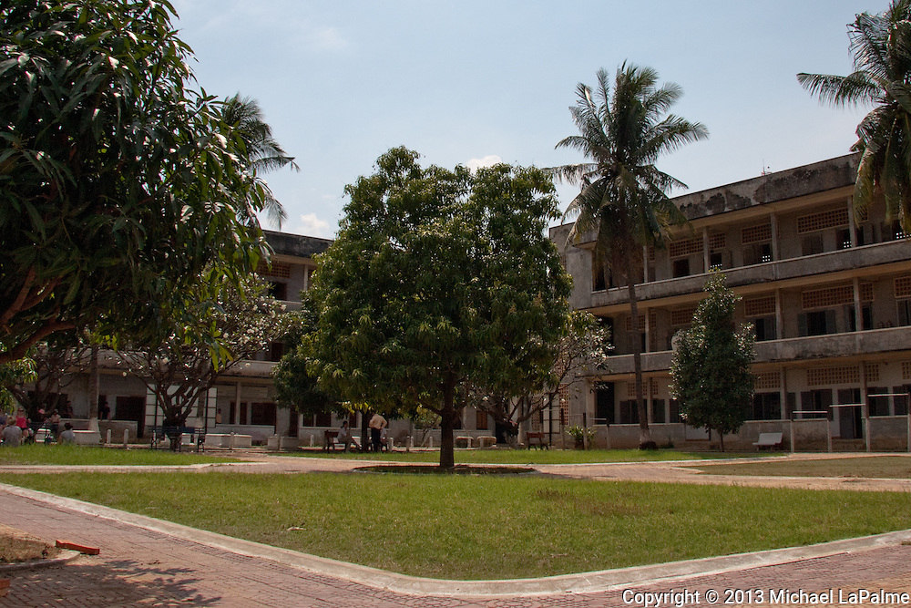 """Street 113, Boeng Keng Kang, Phnom Penh 3, Cambodia - The Tuol Sleng Genocide Museum (Khmer: ???????????????????????????????????????????) is a museum in Phnom Penh, the capital of Cambodia. The site is a former high school which was used as the notorious Security Prison 21 (S-21) by the Khmer Rouge regime from its rise to power in 1975 to its fall in 1979. Tuol Sleng (Khmer [tu?l slae?]) means """"Hill of the Poisonous Trees"""" or """"Strychnine Hill"""". Tuol Sleng was only one of at least 150 execution centers in the country, and as many as 20,000 prisoners there were killed."""