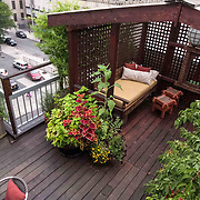 Brooklyn Rooftop Terrace design by Outside Space NYC, featuring custom built cabana, deck and containter garden