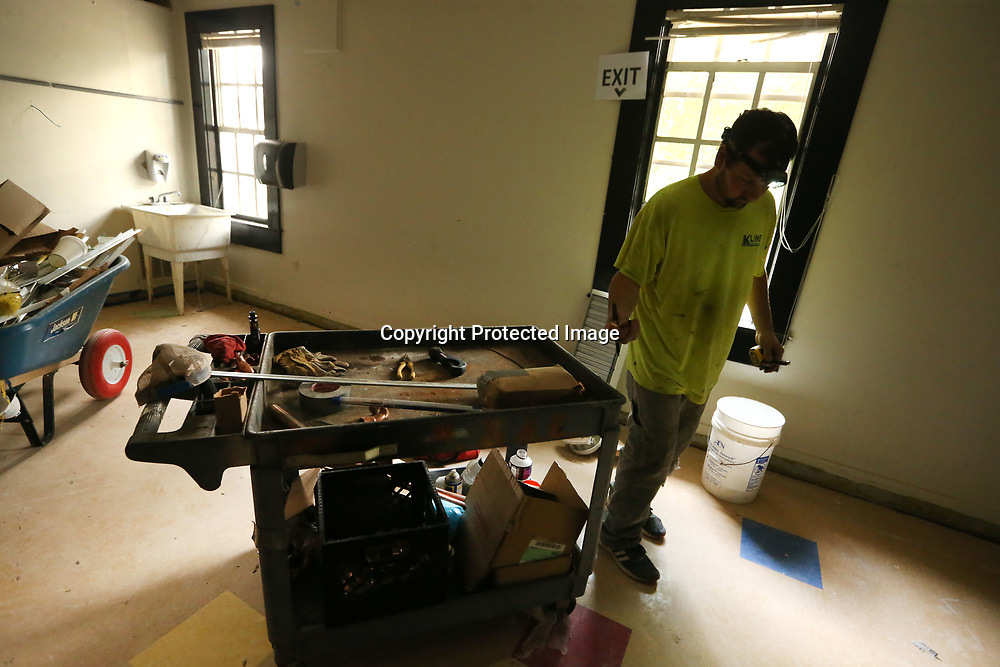 Brant Graham, , of Mantachie, and a employee for Kline Mechanical in Fulton, works on installing a new HVAC unit in a classroom at Lawhon Elementary School in Tueplo.