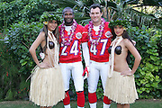 KO OLINA - FEBRUARY 10:  Denver Broncos 2005 NFL Pro Bowl AFC All-Stars (left to right: Champ Bailey #24, John Lynch #47) pose with Hawaiian Hula girls for their 2005 NFL Pro Bowl team photo on February 10, 2005 in Ko Olina, Hawaii. ©Paul Anthony Spinelli