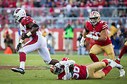 San Francisco 49ers outside linebacker Reuben Foster (56) ties up Arizona Cardinals running back Adrian Peterson (23) at Levi's Stadium in Santa Clara, Calif., on November 5, 2017. (Stan Olszewski/Special to S.F. Examiner)