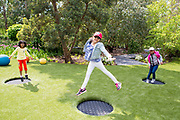 UNITED KINGDOM, London: 16 May 2019 <br /> From left to right, Haniska Nesalingham 7, Aishlyn Khadka 8 and Nureen Zam 8 enjoy bouncing on on elf the installations in Royal Botanical Gardens Kew new Children's Garden which officially opens on the 18th of May 2019. The impressive and colourful space covers 10,000 square metres and is designed around the elements that plants need to survive.<br /> Rick Findler / Story Picture Agency