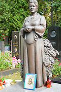 Headstone statue of a woman Novodevichy Cemetery, Moscow, Russia