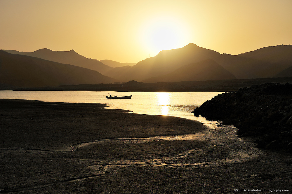 A fishermens boat taking off into the sea at Yiti Beach, Oman, 2011