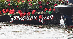 © Licensed to London News Pictures. 22/06/2016. London, UK.  The words Yorkshire Rose written down the side of a a floral tribute boat for the late Jo Cox MP, driven down the River Thames ahead of a memorial service for the Labour MP who was killed in an attack outside her constituency office. Jo Cox would have turned 42 today.   Photo credit: Ben Cawthra/LNP