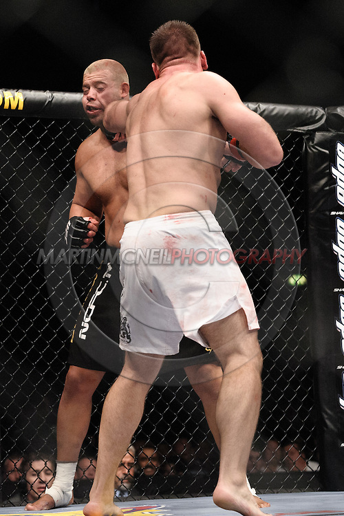"""LONDON, ENGLAND, JUNE 7, 2008: Eddie Sanchez (facing) is wobbled by a straight left from Antoni Hardonk during """"UFC 85: Bedlam"""" inside the O2 Arena in Greenwich, London on June 7, 2008."""