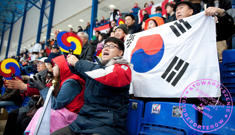 Supporters from South Korea while the Women's 1000 Meters on day three of the 2013 ISU Short Track Speed Skating Junior World Championships at Torwar Ice Hall on February 24, 2013 in Warsaw, Poland...Poland, Warsaw, February 24, 2013...Picture also available in RAW (NEF) or TIFF format on special request...For editorial use only. Any commercial or promotional use requires permission...Photo by © Adam Nurkiewicz / Mediasport