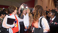 """Paula Radcliffe UK opens the Virgin Marathon London Marathon Expo 2015<br /> <br /> Stopped to pose for a """"Selfie"""" with one of the the first runners queuing to register to receive their bibs.<br /> <br /> Virgin Money London Marathon 2015<br /> <br /> <br /> Photo: Bob Martin for Virgin Money London Marathon<br /> <br /> This photograph is supplied free to use by London Marathon/Virgin Money."""