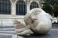 Sculpture of a large head and hand by Henri de Miller in the plaza outside of the Church of St Eustace, Paris, France.