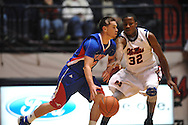 """SMU's Jeremiah Samarrippas (12) vs. Ole Miss' Jarvis Summers (32) at the C.M. """"Tad"""" Smith Coliseum in Oxford, Miss. on Tuesday, January 3, 2012. Ole Miss won 50-48."""