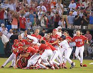 6/25/08 Omaha, NEB  Fresno State dog-piles after winning the College World Series at Rosenblatt Stadium. Photo by Chris Machian