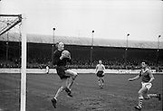 16/02/1964<br /> 02/16/1964<br /> 16 February 1964<br /> Soccer: Cork Hibernians v Drumcondra, 1st round of the F.A.I. Cup at Tolka Park, Dublin. Drums goalie Eamonn Darcy comes out to snatch a ball safe as Guitterez (Cork Hibernians) moves in on the Drums goal.