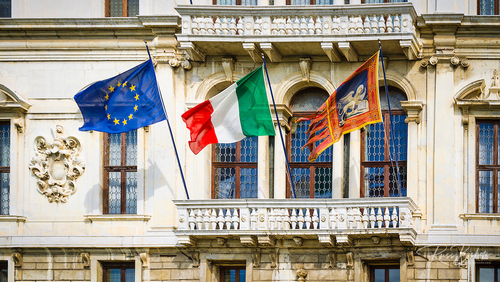 Palazzo and flags on the Grand Canal, Venice, Veneto, Italy