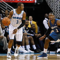 February 1, 2011; New Orleans, LA, USA; New Orleans Hornets point guard Chris Paul (3) is guarded by Washington Wizards point guard John Wall (2) during the second half at the New Orleans Arena. The Hornets defeated the Wizards 97-89.  Mandatory Credit: Derick E. Hingle