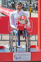 Ernst Van Dyk of South Africa, third placed athlete in the Elite Men's Wheelchair event on the podium at the Virgin Money London Marathon 2014 on Sunday 13 April 2014.<br />