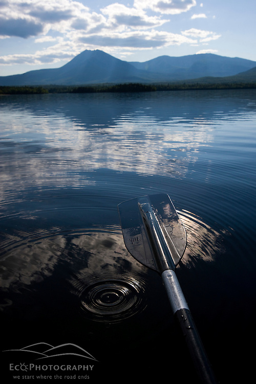 Water drips from a canoe paddle into Katahdin Lake in Maine's Baxter State Park. Mount Katahdin.