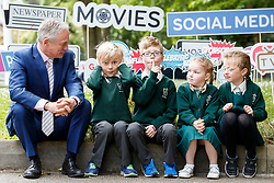 Repro Free: 07/06/2017 Minister for Education and Skills, Richard Bruton T.D. is pictured with pupils of St. Vincent de Paul Infant School, Griffith Avenue, Dublin, Henry Cronin (7), Michael O' Neill (7), Emma Lidierth (7) and Aoibheann Clancy (7) as safefood launch a new free educational resource to help teach primary schoolchildren about the media, advertising and fake news. Picture Andres Poveda