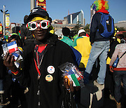 A vendor sells his wares at the Mary Fritzgerald Square, Newtown Johannesburg, 11 June 2010. Thousands of soccer fans flocked the square to watch the first FIFA World Cup opening match between the South African national team, Bafana Bafana and Mexico.