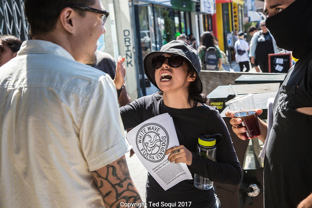 Customers and demonstrators yell at each other.<br /> Boycott and demonstration against Weird Wave Coffee House on Caesar E. Chavez Ave in Boyle Heights. About 25 demonstrators held signs and chanted slogans out front of the coffee house.