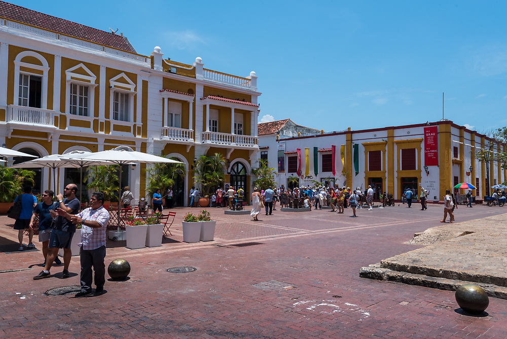 Cartagena, Colombia--April 21, 2018. People are walking about in front of a musem in a public square in Cartagene. Editorial use only.