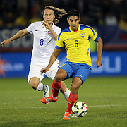 Mix Diskerud, (left), USA, challenges Christian Noboa, Ecuador, during the USA Vs Ecuador International match at Rentschler Field, Hartford, Connecticut. USA. 10th October 2014. Photo Tim Clayton