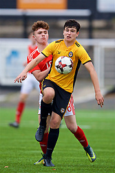 MERTHYR TYDFIL, WALES - Thursday, November 2, 2017: Wales' Callum Flynn and Newport County's Sam Roberts during an Under-18 Academy Representative Friendly match between Wales and Newport County at Penydarren Park. (Pic by David Rawcliffe/Propaganda)
