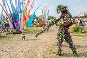 Pilton, Somerset, UK. 29th June 2019.   - Tree people entertain in the Circus area - The 2019 Glastonbury Festival, Worthy Farm. Glastonbury.
