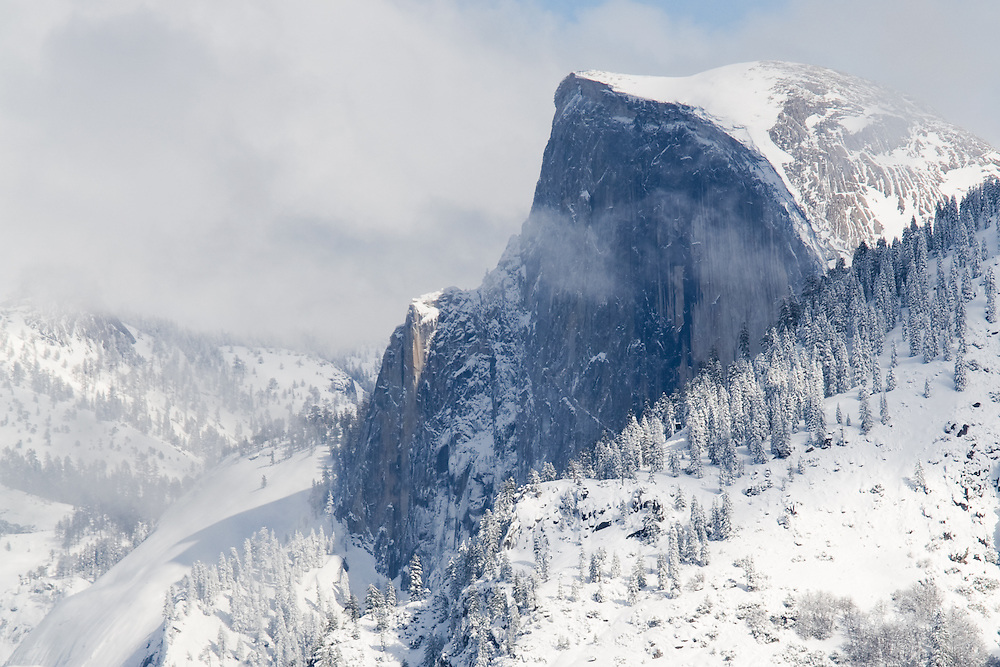 Storm clouds enshrouding Half Dome in winter.