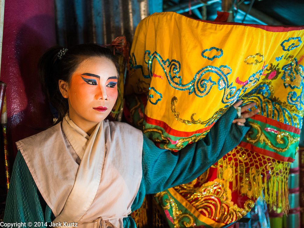 23 SEPTEMBER 2014 - BANGKOK, THAILAND: A performer in the Chinese opera waits to go on stage on the first day of the Vegetarian Festival at the Chit Sia Ma Chinese shrine in Bangkok. The Vegetarian Festival is celebrated throughout Thailand. It is the Thai version of the The Nine Emperor Gods Festival, a nine-day Taoist celebration beginning on the eve of 9th lunar month of the Chinese calendar. During a period of nine days, those who are participating in the festival dress all in white and abstain from eating meat, poultry, seafood, and dairy products. Vendors and proprietors of restaurants indicate that vegetarian food is for sale by putting a yellow flag out with Thai characters for meatless written on it in red.    PHOTO BY JACK KURTZ